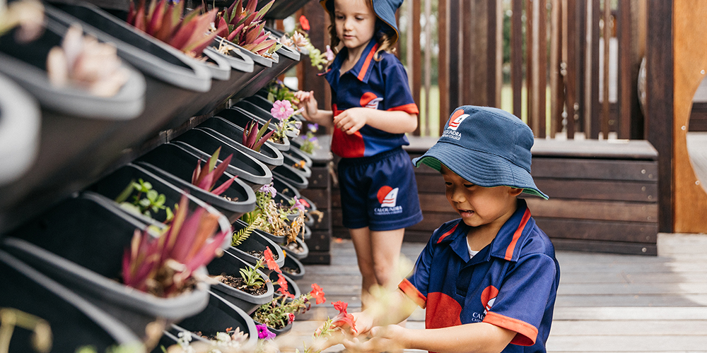 Caloundra Christian College Prep boy and girl with plants in playground